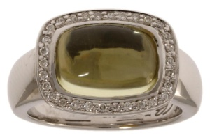 14 krt witgouden damesring met daarin in een Lemonquarts en 0.15crt diamant