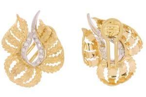 Occasion bicolor gouden oorclips met diamant